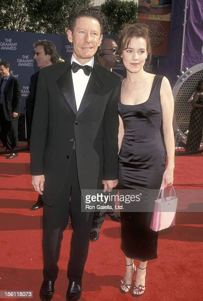 Musician Lyle Lovett and girlfriend April Kimble attend the 41st Annual Grammy Awards on February 24 1999 at Shrine Auditorium in Los Angeles...