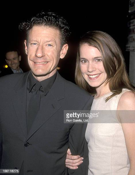 Musician Lyle Lovett and girlfriend April Kimble attend the 'Cookie's Fortune' Hollywood Premiere on March 29 1999 at Cineplex Odeon Showcase Theatre...