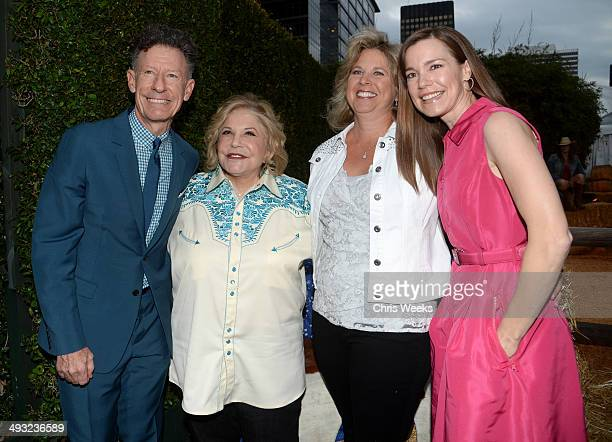 Musician Lyle Lovett Annenberg Foundation Chairman of the Board President CEO Wallis Annenberg guest and April Kimble attend the Annenberg Space for...