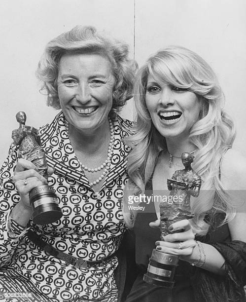 Musician Lynsey De Paul with her Best Television Theme award for the song 'No Honestly' and singer Vera Lynn with her special award for services to...