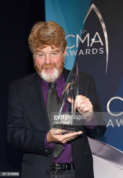 Musician Mac McAnally celebrates winning the Musician of the Year awards during the 51st annual CMA Awards at the Bridgestone Arena on November 8...