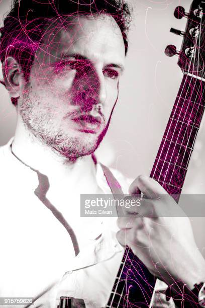Musician Man Holding his Guitar