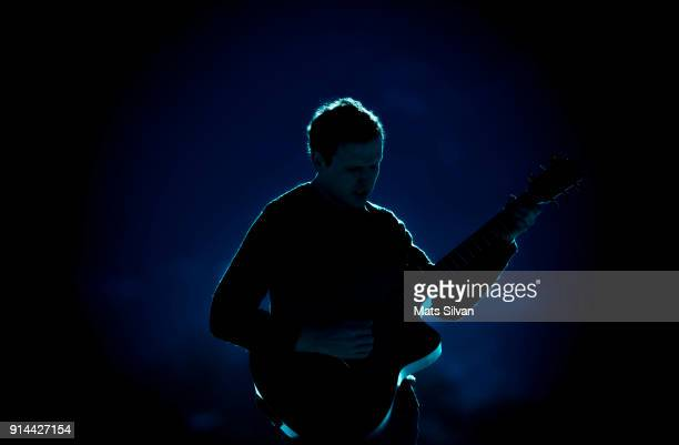 musician man playing on his guitar with backlit - musician stock pictures, royalty-free photos & images