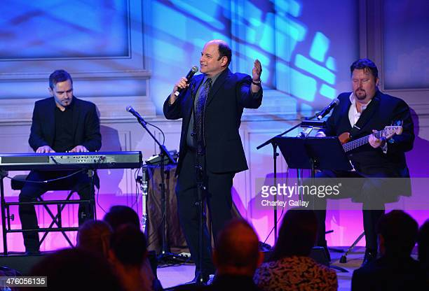 Musician Marcus Byrne actor Jason Alexander and musician Eliot Kennedy perform onstage at The Weinstein Company's Academy Award party hosted by...