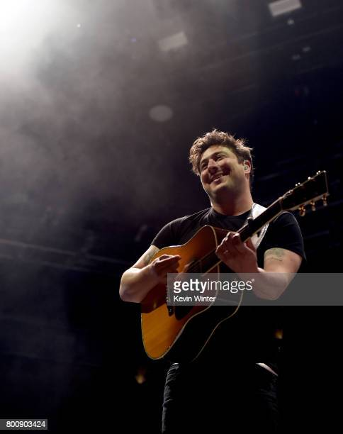 Musician Marcus Mumford of musical group Mumford Sons performs on The Oak stage during Arroyo Seco Weekend at the Brookside Golf Course at on June 25...