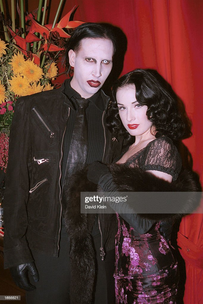 Musician Marilyn Manson And Dancer Dita Von Teese Attend The Playboy
