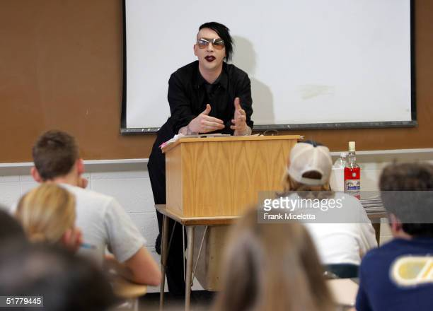 """Musician Marilyn Manson speaks to students at Temple University's """"Art & Society"""" class during a taping of mtvU's """"Stand In"""" special, November 22,..."""
