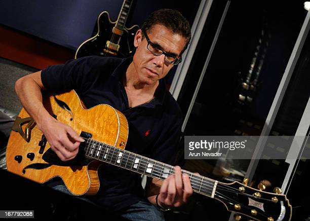 Musician Mark Hammond plays guitar during the Kaylene Peoples My Man Recording Session with Hubert Laws at The Mouse House Studio on April 29 2013 in...