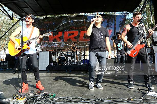 Musician Mark Hoppus of Blink182 performs onstage with Alex Gaskarth and Zack Merrick of All Time Low at the KROQ Weenie Roast Y Fiesta 2015 at...