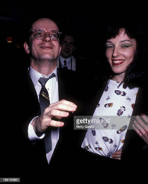 Musician Mark Mothersbaugh of Devo and date attend the screening of 'Star Struck' on January 25 1983 at Mann Fine Arts Theater in Beverly Hills...