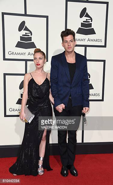 Musician Mark Ronson and Josephine de La Baume arrive on the red carpet for the 58th Annual Grammy music Awards in Los Angeles February 15 2016 AFP...