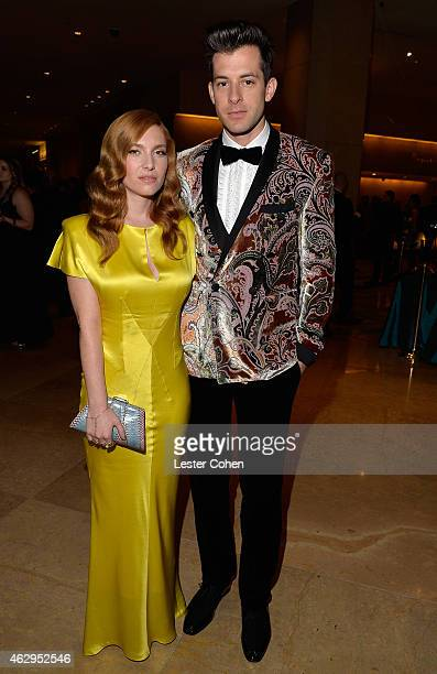 Musician Mark Ronson and Josephine de La Baume attend the PreGRAMMY Gala and Salute To Industry Icons honoring Martin Bandier at The Beverly Hilton...
