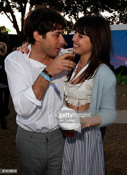 LONDON JULY 03 Musician Mark Ronson and Model Daisy Lowe stay close together behind the main stage in the O2 VIP Lounge during Day One of the O2...