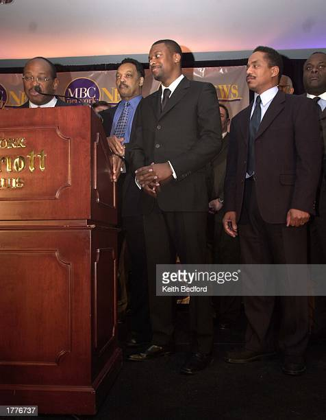 Musician Marlon Jackson actor Chris Tucker and Reverend Jesse Jackson listen to Major Broadcasting Cable Network's Chairman and CEO Willie Gary at a...