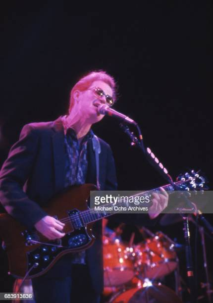 Musician Marshall Crenshaw performs onstage with an electric guitar in 1985