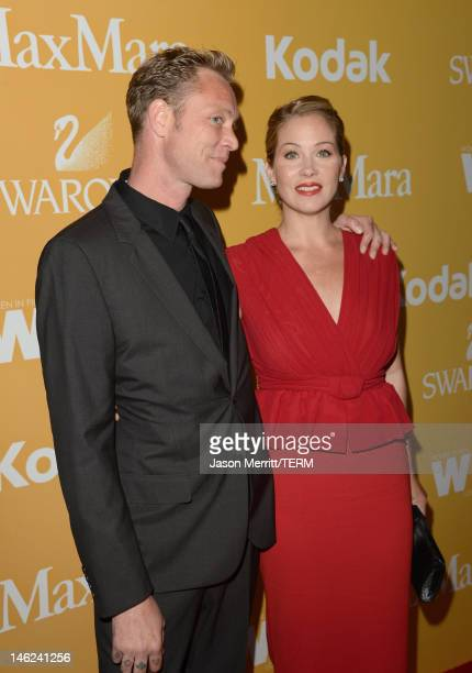Musician Martyn LeNoble and actress Christina Applegate arrive at the 2012 Women In Film Crystal Lucy Awards held at The Beverly Hilton Hotel on June...