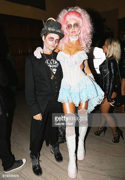 Musician Matt Bellamy and model Elle Evans attend Trick or treats The 6th Annual treats Magazine Halloween Party Sponsored by Absolut Elyx on October...