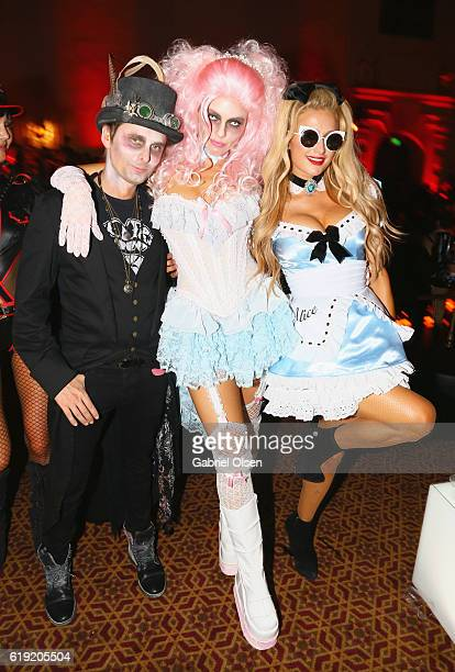 Musician Matt Bellamy model Elle Evans and Paris Hilton attend Trick or treats The 6th Annual treats Magazine Halloween Party Sponsored by Absolut...