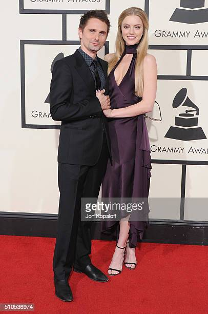 Musician Matt Bellamy of Muse and Elle Evans arrive at The 58th GRAMMY Awards at Staples Center on February 15 2016 in Los Angeles California