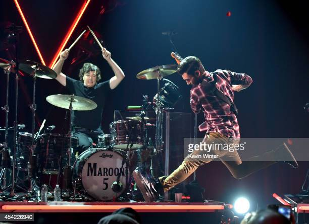 Musician Matt Flynn and singer Adam Levine of Maroon 5 perform onstage druing the iHeartRadio Album Release Party with Maroon 5 LIVE on the CW at...