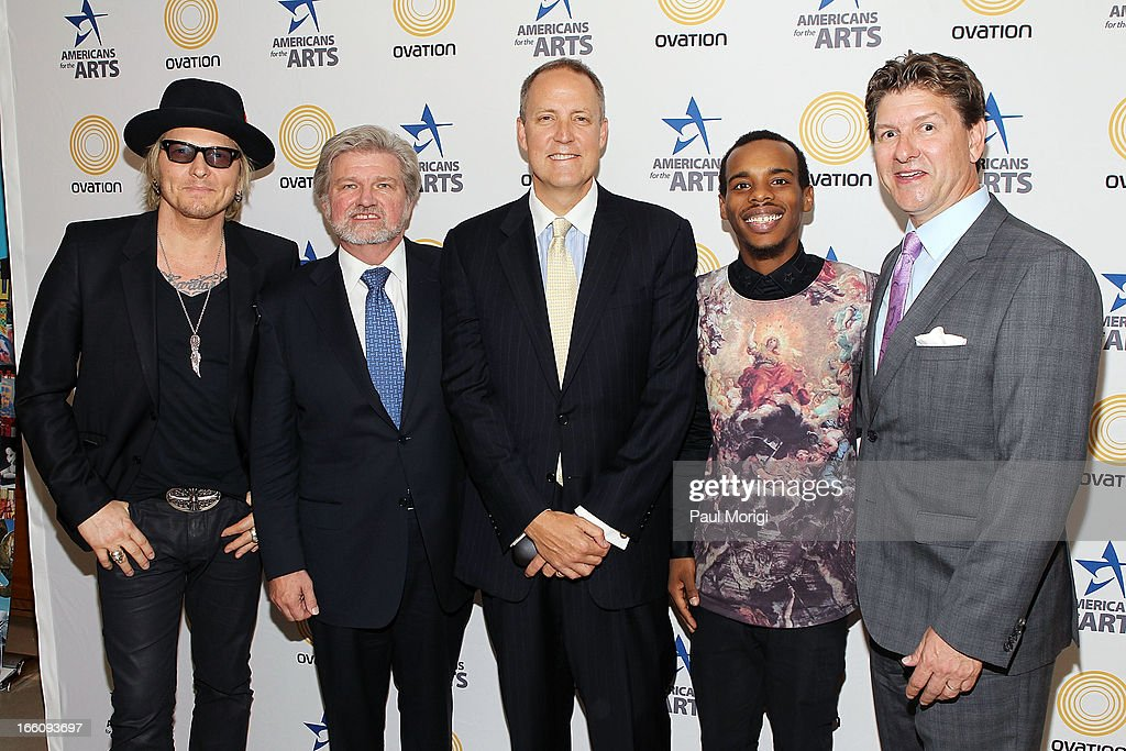 Musician Matt Sorum, AFTA President and CEO Robert Lynch, Ovation CEO Charles Segars, performer Lil Buck and Lyndon Boozer pose for a photo backstage at The Nancy Hanks Lecture on Art and Public Policy sponsored by Ovation at John F. Kennedy Center for the Performing Arts on April 8, 2013 in Washington, DC.