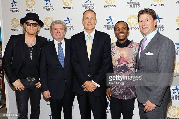 Musician Matt Sorum AFTA President and CEO Robert Lynch Ovation CEO Charles Segars performer Lil Buck and Lyndon Boozer pose for a photo backstage at...