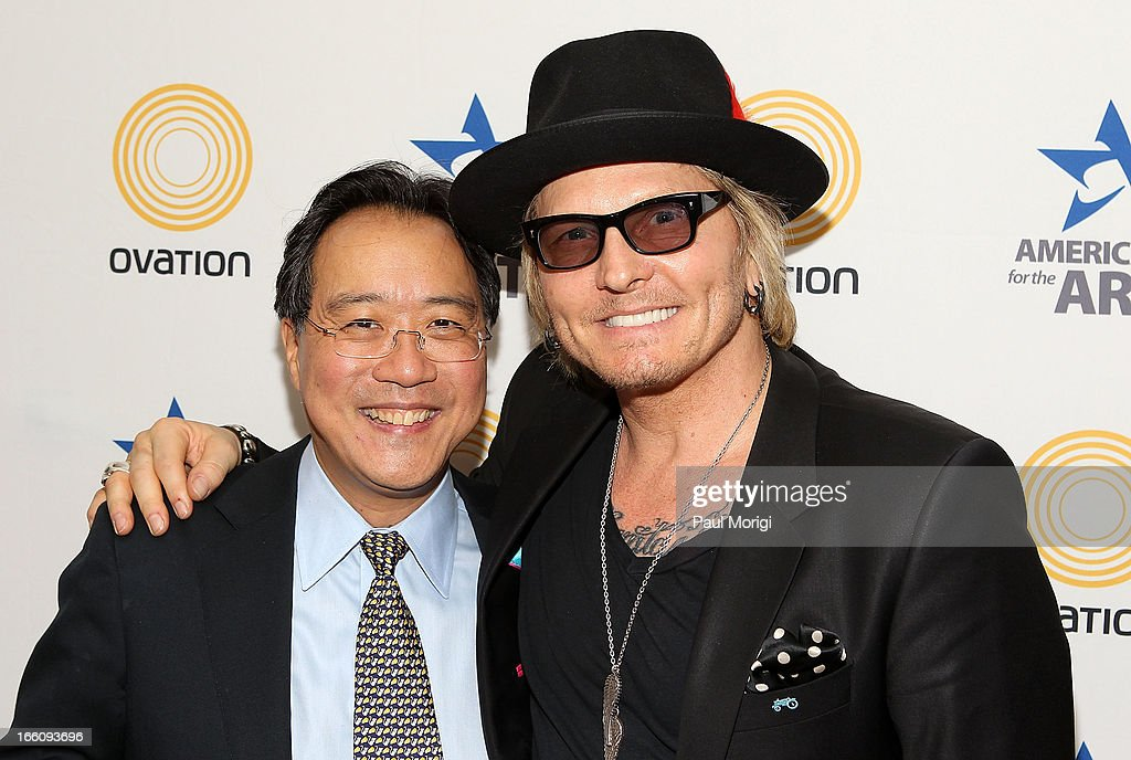 Musician Matt Sorum (L) and acclaimed artist and arts educator Yo-Yo Ma pose for a photo backstage at The Nancy Hanks Lecture on Art and Public Policy sponsored by Ovation at John F. Kennedy Center for the Performing Arts on April 8, 2013 in Washington, DC.