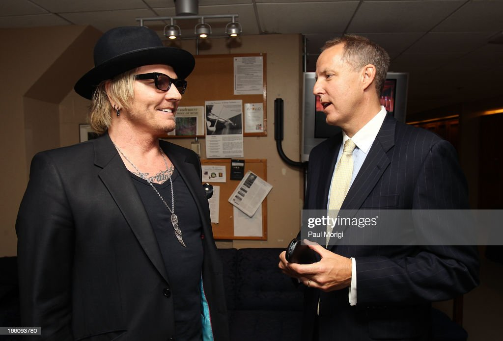 Musician Matt Sorum (L) and Ovation CEO Charles Segars talk backstage at The Nancy Hanks Lecture on Art and Public Policy sponsored by Ovation at John F. Kennedy Center for the Performing Arts on April 8, 2013 in Washington, DC.