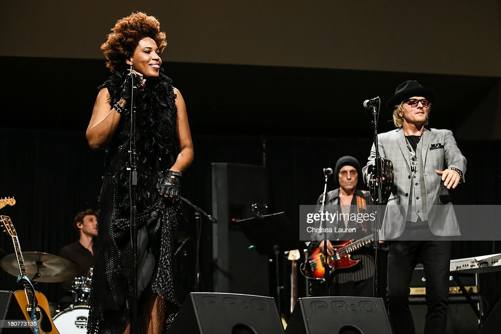 Musician Matt Sorum (R) and singer Macy Gray perform at Adopt the Arts' Peace Through Music celebrity gala at Loews Hollywood Hotel on September 15, 2013 in Hollywood, California.