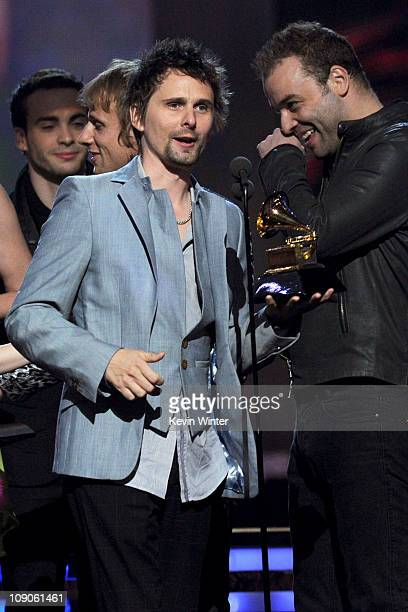 """Musician Matthew Bellamy and Christopher Wolstenholme of the band Muse accpet the Best Rock Album award for """"The Resistance"""" onstage during The 53rd..."""