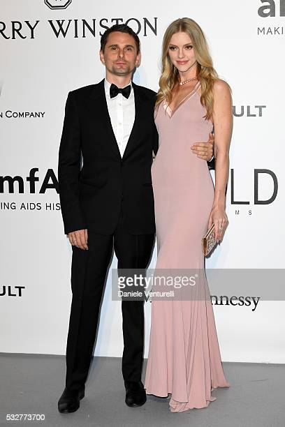 Musician Matthew Bellamy and model Elle Evans attends the amfAR's 23rd Cinema Against AIDS Gala at Hotel du CapEdenRoc on May 19 2016 in Cap...