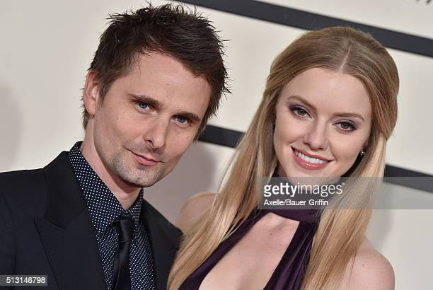 Musician Matthew Bellamy of Muse and model Elle Evans arrive at The 58th GRAMMY Awards at Staples Center on February 15 2016 in Los Angeles California