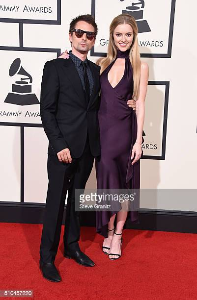 Musician Matthew Bellamy of Muse and model Elle Evans attend The 58th GRAMMY Awards at Staples Center on February 15 2016 in Los Angeles California