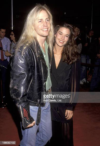 Musician Matthew Nelson and Actress Brooke Langton attend the 'JFK' Westwood Premiere on December 7 1991 at Mann Village Theatre in Westwood...