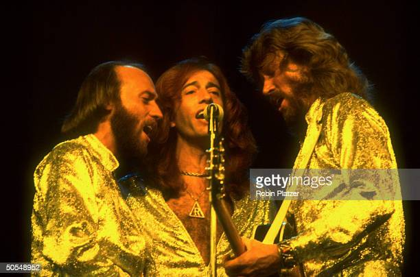 Musician Maurice Robin and Barry Gibb of the Bee Gees singing on stage