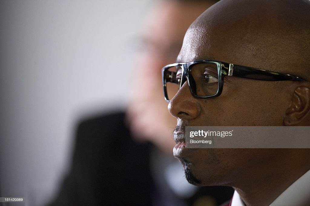 """Musician MC Hammer, also known as Stanley Burrell, listens to a panel discussion inside the Bloomberg Link during day three of the Democratic National Convention (DNC) in Charlotte, North Carolina, U.S., on Thursday, Sept. 6, 2012. Four years after the nation made history by electing him the first African-American president, Barack Obama asked for a second term with a pledge to keep rebuilding a battered economy in a way that """"may be harder but it leads to a better place."""" Photographer: David Paul Morris/Bloomberg via Getty Images"""