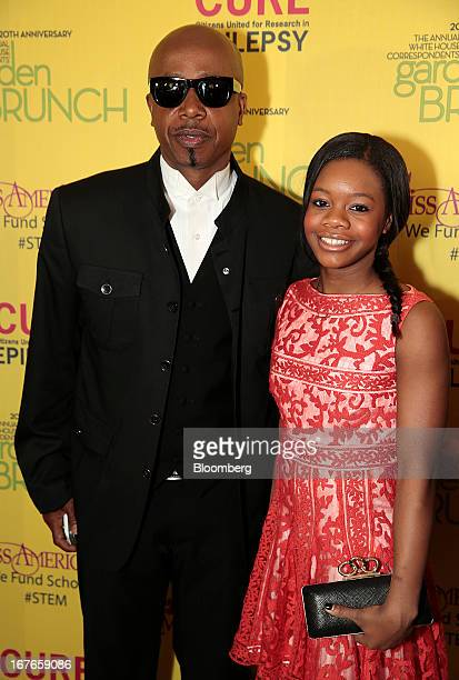 Musician MC Hammer left and US Olympic gold medalist Gabby Douglas attend the 20th Annual White House Correspondents' Garden Brunch in Washington DC...
