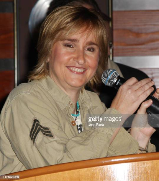 Musician Melissa Etheridge accepts a check for breast cancer research at the Hard Rock Cafe November 17 2007 in Hollywood Florida