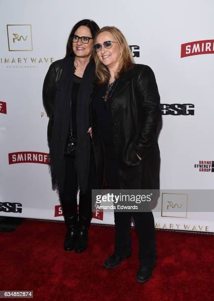 Musician Melissa Etheridge and Linda Wallem arrive at the Primary Wave 11th Annual Pre-GRAMMY Party at The London West Hollywood on February 11, 2017...