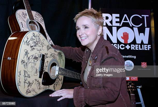 """Musician Melissa Etheridge signs a Gibson guitar backstage at the """"ReAct Now: Music & Relief"""" benefit concert at Paramount Studios on September 10,..."""
