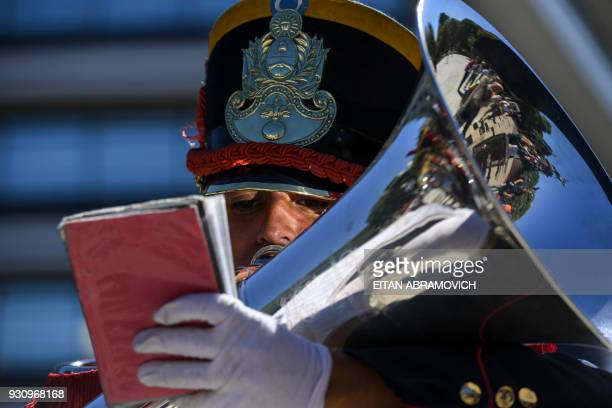 A musician member of regiment of mounted grenadiers plays the trombone during a wreathlaying ceremony at San Martin square in Buenos Aires on the...