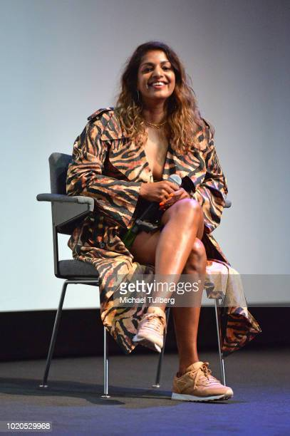 Musician MIA talks to the audience during a QA at the premiere of Abramorama's 'Matangi/Maya/MIA' at The Theatre at Ace Hotel on August 20 2018 in...