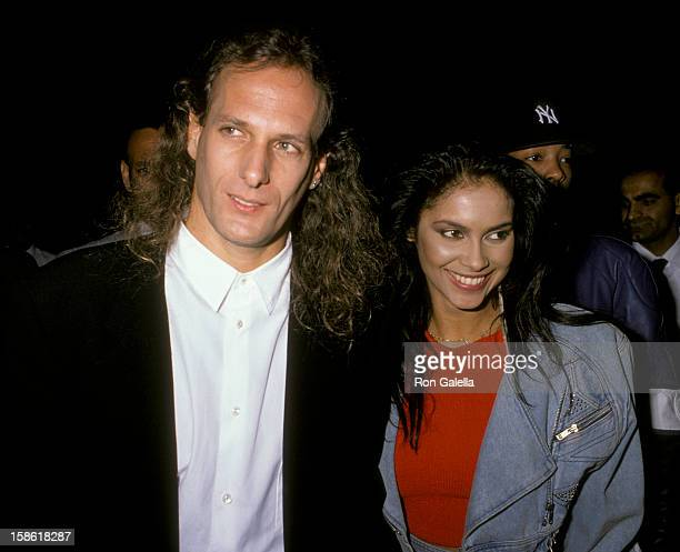 Musician Michael Bolton and singer Vanity attend Virgin Records Party on February 23 1990 at Pazzia Restaurant in Los Angeles California
