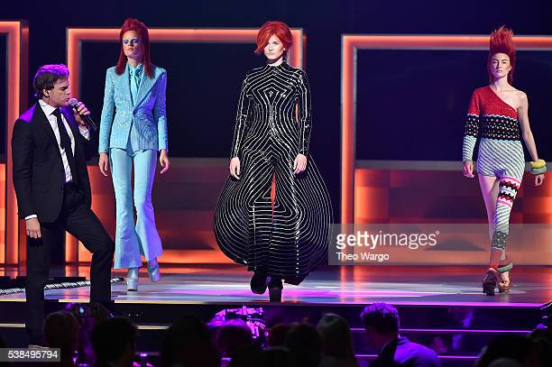Musician Michael C Hall performs a tribute to David Bowie as models display fashions onstage at the 2016 CFDA Fashion Awards at the Hammerstein...
