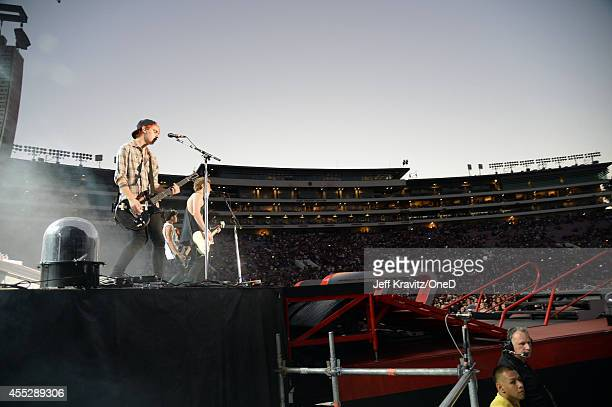 Musician Michael Clifford of 5 Seconds of Summer performs onstage during the One Direction Where We Are Tour at Rose Bowl on September 11 2014 in...