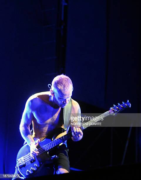 Musician Michael Flea Balzary of Red Hot Chili Peppers performs onstage during a show in Asuncion Paraguay on November 5 2013 AFP PHOTO / Norberto...