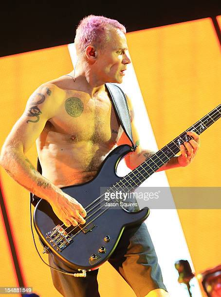 Musician Michael Flea Balzary of Red Hot Chili Peppers performs at Sprint Center on October 27 2012 in Kansas City Missouri