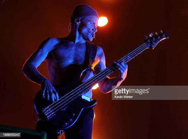 """Musician Michael """"Flea"""" Balzary of the band Red Hot Chili Peppers performs onstage during day 3 of the 2013 Coachella Valley Music & Arts Festival at..."""