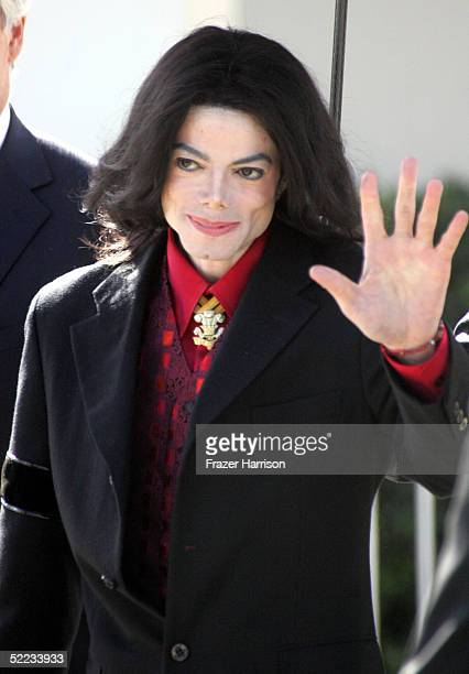 Musician Michael Jackson gestures as he departs the Santa Barbara County Courthouse during the jury selection phase of his child molestation trial...