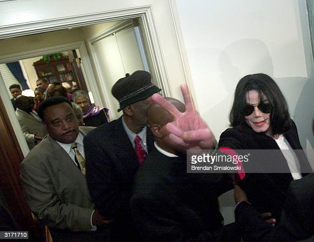 Musician Michael Jackson makes his way out of a House office during a visit to Capitol Hill March 30 2004 in Washington DC The 'King of Pop' visited...